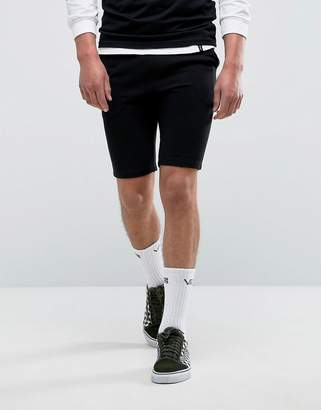 Asos DESIGN Jersey Skinny Shorts In Black