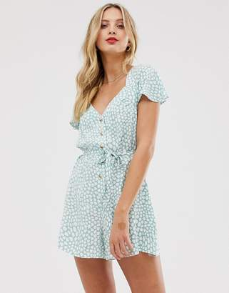 Asos Design DESIGN frill sleeve romper with cut out back in animal print