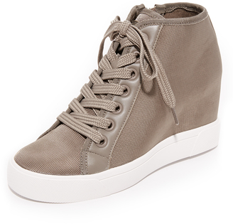 DKNY Cindy Wedge Sneakers $198 thestylecure.com