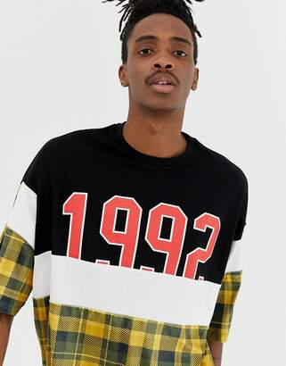Asos DESIGN oversized t-shirt with velour check cut and sew panels and 1992 print and half sleeve