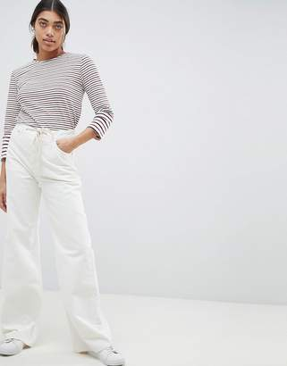 Asos DESIGN skater jeans in aged white with rope belt