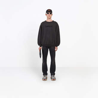 Balenciaga Oversize fit hand washed-out sweater with 'sinners' message embroidered at front