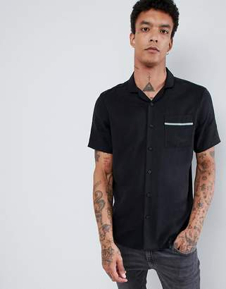 Asos DESIGN regular fit tencel revere collar shirt with tape in black