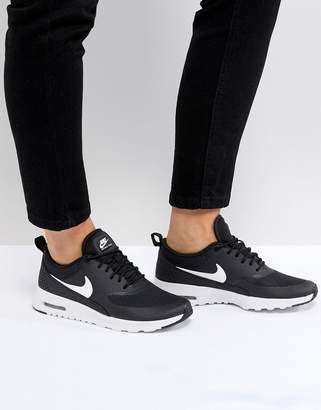 Nike Thea Trainers In Black And White
