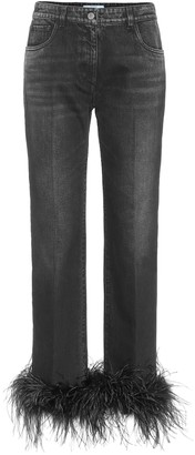 Prada High-rise feather-trimmed jeans