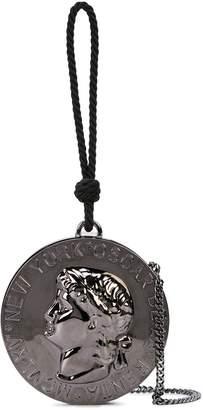 Oscar de la Renta coin-shaped clutch
