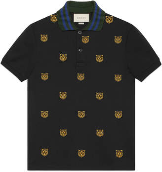 Cotton polo with tiger head embroidery $670 thestylecure.com