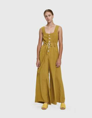 42892c6ac444 Farrow Willy Buttoned Linen Jumpsuit in Mustard