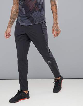 Reebok Training Speedwick Woven Tapered Joggers In Black CD5177