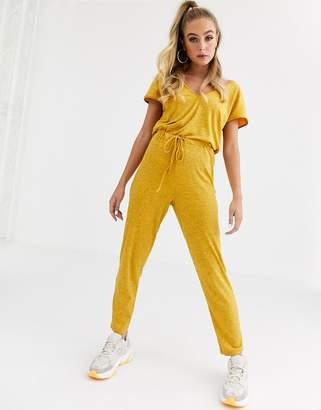 Asos Design DESIGN v neck lounge wear jumpsuit with tie waist