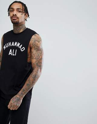Asos DESIGN Muhammad Ali sleeveless t-shirt with dropped armhole