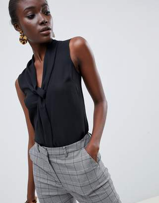Warehouse sleeveless tie front top in black