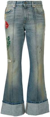 Gucci embroidered flared jeans with turned cuffs