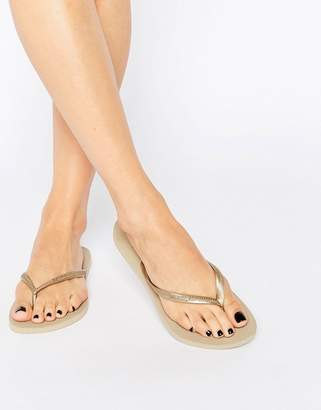 c5b6946d98a Havaianas Slim Flip Flops In Gold - ShopStyle UK