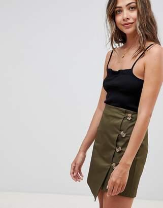 Asos DESIGN asymmetric wrap mini skirt with button front
