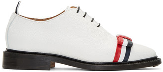 Thom Browne White Wholecut Bow Oxfords $1,050 thestylecure.com