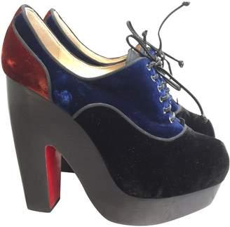 Christian Louboutin Velvet open toe boots