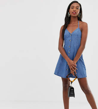 Asos Tall DESIGN Tall denim halter neck mini dress with buttons in midwash blue