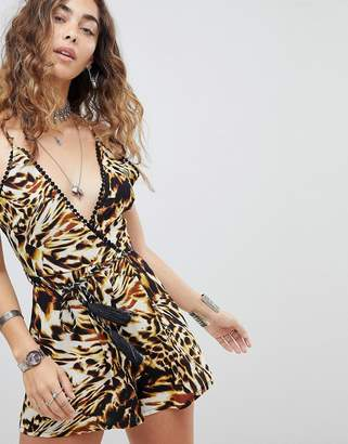 Kiss The Sky Cross Back Romper In Tiger Print