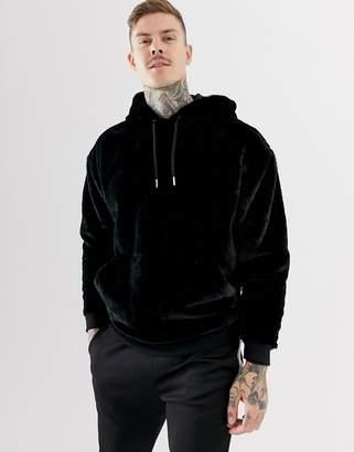 Asos DESIGN oversized faux fur hoodie in black