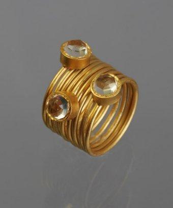 Kevia set of 9 - gold plain and crystal rings