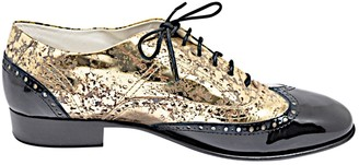 Chanel Gold Patent leather Flats