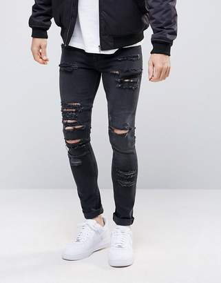 Asos DESIGN super skinny jeans in 12.5oz with mega rips in washed black