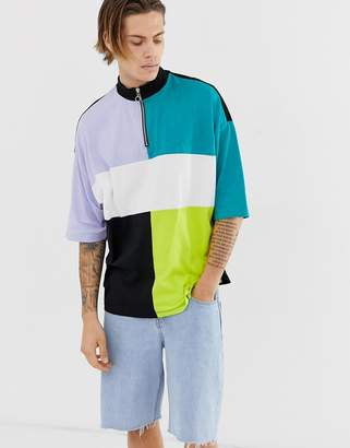 Asos Design DESIGN organic oversized t-shirt with turtle zip neck and half sleeve with colour block and side vents