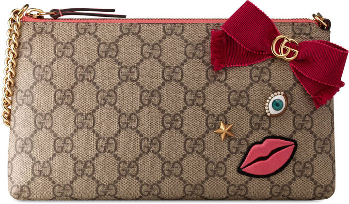 Gucci Chain wrist wallet with embroidered face