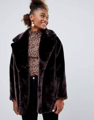 Monki faux fur jacket in brown