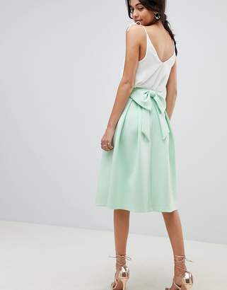 Asos DESIGN scuba prom skirt with bow back detail