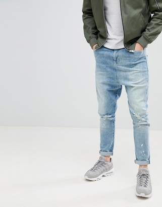 Asos DESIGN Drop Crotch Jeans In Mid Wash Blue With Rips