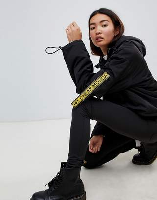 Cheap Monday cropped anorak with multi pockets and logo taping