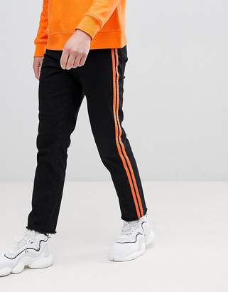 Asos DESIGN Stretch Slim Ankle Grazer Jeans In Black With Orange Side Stripe