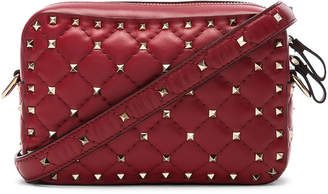 Valentino Rockstud Spike Crossbody Bag in Red | FWRD