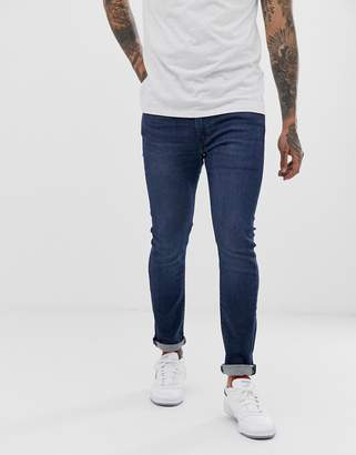 Levi's 519 super skinny fit low rise jeans in sage overt advanced mid wash