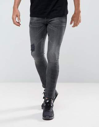 Asos Extreme Super Skinny Jeans In Washed Black with Rips