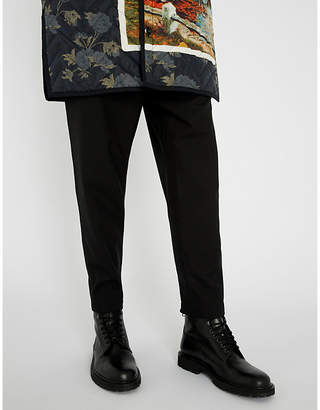 Oamc Relaxed-fit tapered stretch-wool trousers
