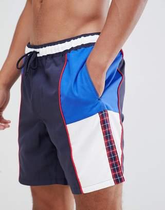 Asos DESIGN swim shorts in retro cut & sew with plaid tape mid length