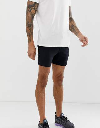 Asos Design DESIGN jersey skinny shorts in shorter length in black
