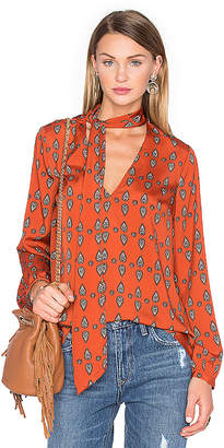 House of Harlow 1960 x REVOLVE Naomi Tie Neck Blouse in Rust $148 thestylecure.com