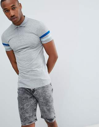 Asos Design DESIGN muscle fit polo with contrast sleeve panels