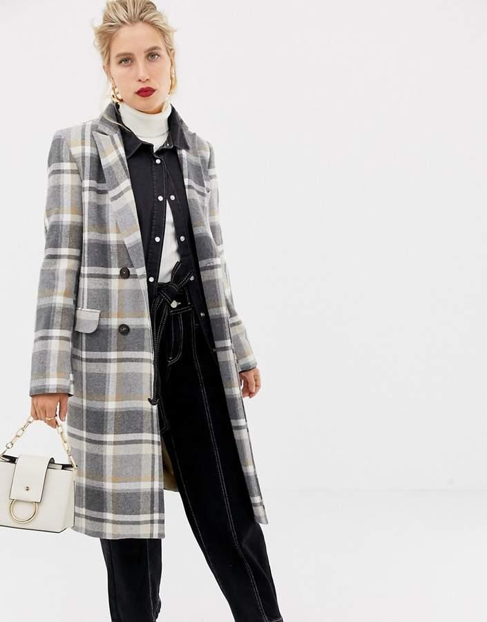 Stradivarius white based check coat