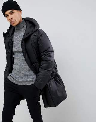 Asos DESIGN oversized puffer jacket with detachable mittens in black