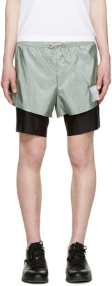 "Satisfy Green & Black Long Distance 8"" Shorts $400 thestylecure.com"