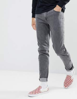 Asos DESIGN Skinny Jeans In Washed Black With Popper Detail