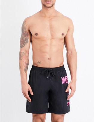 Moschino Flamingo logo-print swim shorts $90 thestylecure.com