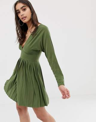 Asos Design DESIGN jersey crepe v neck mini dress with pleated skirt
