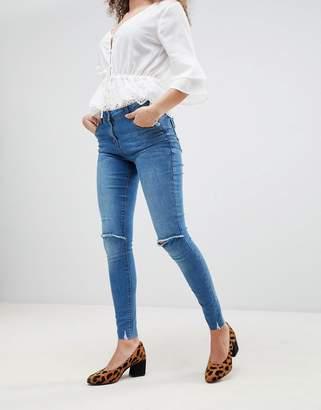 Parisian frayed hem skinny jeans with ripped knee