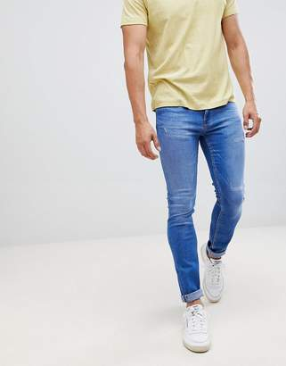 Burton Menswear jeans in skinny fit in mid blue wash